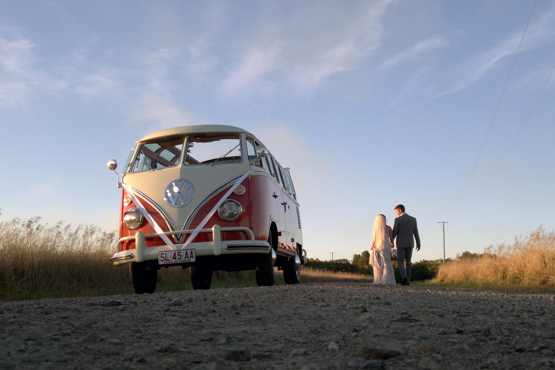 Newly weds enjoy Sunset with VW wedding transport.